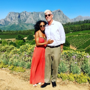 Interracial couple standing in a vineyard